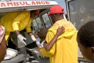 Martissant, Port-au-Prince. Haitian Red Cross workers evacuate Darmela (8), who has contracted cholera.