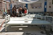 In the courtyard of Port au Prince civilian prison, these beds are to equip the cholera treatment centre.