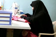 Najaf. This women is now earning money making clothes, after the ICRC helped her set up in business.