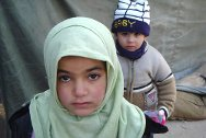 Basra, Bucca camp. A little girl and boy who came with their mother to visit their detained father.