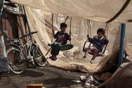 Zafraniya, Baghdad. Internally displaced children play in a makeshift playground.