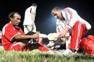 It's not a medic but an orthopaedic technician who runs onto the field – Nazih gets his prosthesis checked during a pause in the game.