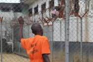 Liberia. Family visits and access to the open air are important for the detainees' well-being.