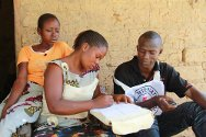 Nimba County, Liberia. Ivorian refugee Rebecca, who was separated from her parents, writes a Red Cross message with the help of ICRC tracing field officer Fred T. Tosah.