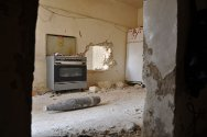 Ajdabiya, Libya. This shell entered the kitchen of a house through a wall but failed to explode.