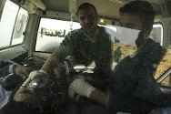 Ras Lanuf, Libya. Doctors evacuate a casualty from the fighting.
