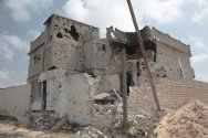 The bombed-out shell of this building illustrates the heavy fighting that took place in Misrata.