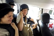Tripoli, Libya. Journalists are evacuated from the Rixos Hotel in an ICRC vehicle on 24 August 2011.