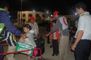 Port of Tripoli. Passengers boarding the ship were assisted by ICRC staff and Libyan Red Crescent volunteers.