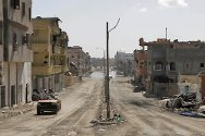 Sirte, Libya. Destroyed buildings along one of the main streets.