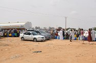 East of Sirte. Displaced families from Sirte queue for fuel brought in by tanker so that they can move to safer areas further east.
