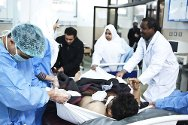 Al Jalaa Hospital, Benghazi. Libyan doctors and nurses treat a patient in the accident and emergency unit.