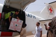 Sabha Airport, Libya. Staff unload measles vaccine.