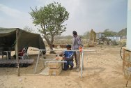 ICRC engineers install a water distribution point at Choucha camp in Tunisia, close to the Libyan border.