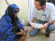 Mauritania. Ali's mother receiving news from her son with the help of an ICRC delegate.