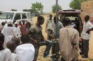 Ungogo, Kano state, Nigeria. Schoolchildren watch the drilling of a water borehole.