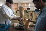 Pakistan Institute of Prosthetic and Orthotic Sciences, Peshawar, Khyber Pakhtunkhwa province, Pakistan. Staff at the ICRC-supported centre adjust an artificial limb before testing it on the patient.
