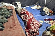 Palestinian children sleep in a tent. The tent was erected after their house was destroyed during the Israeli military operation in 2008/2009.