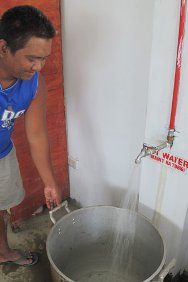 Valencia City Jail, Philippines. Solar-heated water saves precious time and manpower. The water is used to cook rice for more than 100 detainees.