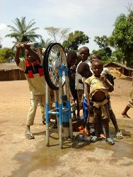 DRC, Orientale province, Dungu. Children use one of the 40 rope pumps installed by the ICRC