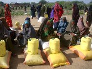 Southern Somalia, Middle Juba region, Jilib district, camp for displaced people. Women, heads of family, residents and internally displaced people sit on their piles of one-month food rations.