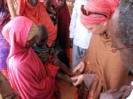 Abudwaq, Galgaduud region, Somalia, August 2011. Hilary Floate, ICRC nutritionist for Somalia, performs the