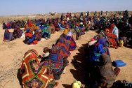 Bakool province. Displaced people, mainly single female heads of families, waiting to receive tomato and sorghum seed. They will also receive leaflets on how to optimize production.