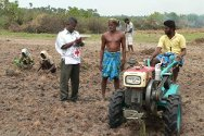 Karainager Island, Jaffna. This farmer is using a tractor donated by the ICRC.
