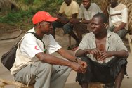 Village near Yambio, southern Sudan. Lucas and Dido, a Sudanese Red Crescent tracing volunteer