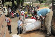 Bariguna, Western Equatoria, South Sudan. Displaced persons collect household items.