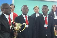 Pan-African moot court competition, Arusha, Tanzania. The University of Zimbabwe team with their trophy. With them are Judge Seon Ki-Park of the ICTR (in red) and representatives of the ICTR and the ICRC.