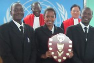 Pan-African moot court competition, Arusha, Tanzania. The team from Egerton University, Kenya, holding the runners-up trophy. With them are Judges Gustave Kam and Seon-Ki Park of the ICTR.