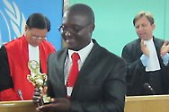 Pan-African moot court competition, Arusha, Tanzania. Zimbabwe's Taona Nyamakura receives the best speaker award at the closing ceremony.