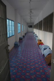 Rachaburi Prison, Thailand. In the overcrowded prison, corridors are transformed into dormitories.