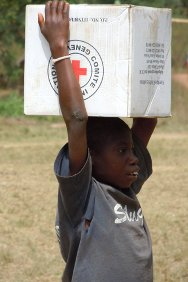 Côte d'Ivoire. A boy carefully carries a carton of supplies back to his family following an ICRC distribution operation for people displaced by the fighting.