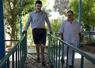A mine victim learns to walk again at the ICRC orthopaedic centre in Erbil City.