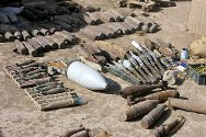 Unexploded ordnance gathered by ICRC explosive ordnance disposal staff in Missan Governorate. Nearly 120 lethal devices were removed from a farmer's field.