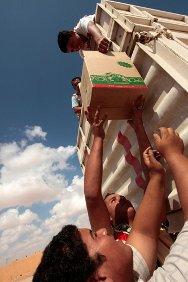 Washka, 100 km west of Sirte, Libya. Staff unload supplies before an ICRC/Libyan Red Crescent distribution operation.