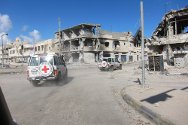 Sirte, Libya. An ICRC assessment team advances through Sirte, in ruins following weeks of heavy fighting.