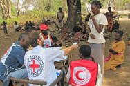 Bariguna, Western Equatoria, South Sudan. ICRC and Sudanese Red Crescent staff distribute household items to displaced persons.