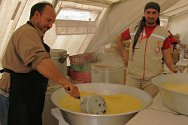 Choucha Camp, Tunisia. Cook Abdessalem Jnissan prepares couscous with the assistance of a volunteer from the Tunisian Red Crescent.