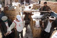 Amran governorate, Yemen. Yemen Red Crescent staff distribute two-month food rations to around 10,000 IDPs from the governorates of Amran and Sa'ada.