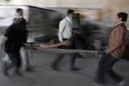25.10.2011. Wounded anti-government protesters are being rushed to a makeshift clinic after clashes with police in Sana'a.