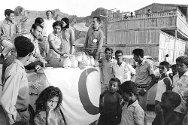 Aden, Yemen, 1972. Yemen Red Crescent distributes milk.