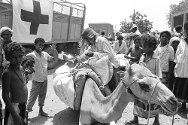 Aden, Yemen, 1994. Families affected by war receive food.