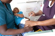 Zimbabwe, 2010. A mother with her baby at Glenview polyclinic, in for a regular check-up and vaccination