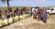 Uganda. People queuing for water at the newly drilled borehole in water-stressed Meriwala Village in Kotido District.