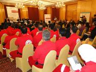 Cairo. Participants sit beside Egyptian Red Crescent volunteers wearing their distinctive red uniform.