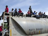 Tenosique, Mexico. Migrants from central America aboard a freight train. Every journey brings the risk of death from accidents or violence.