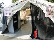 Cairo. An exhibition tent was placed at the entry of the Health Care in Danger workshop, depicting a field hospital damaged by arms carriers.